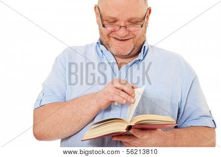 Charismatic middle aged man reading book. All on white background.