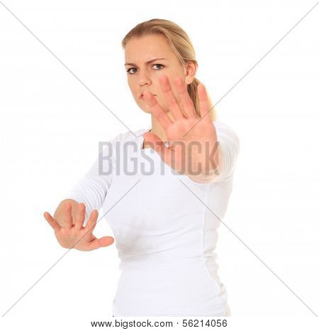 Attractive young woman with repelling gesture. All on white background.
