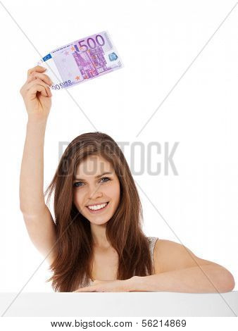 Attractive teenage girl holding 500 euro. All on white background.