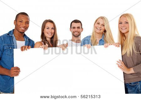 Group of young people standing behind white placeholder. All on white background.