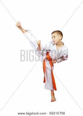 Athlete on a white background in a kimono performs a high blow foot