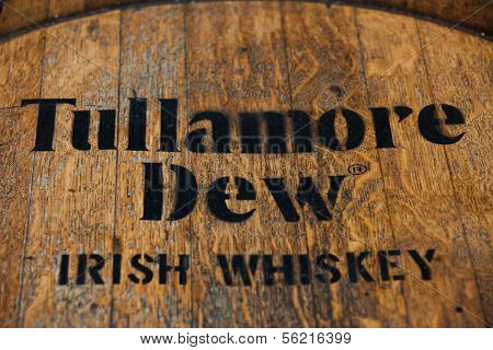 DUSSELDORF, GERMANY - SEPTEMBER 4, 2013: Tullamore Dew Irish whiskey brandmark on rustic whiskey jar.