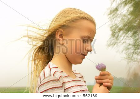 Girl Taking Spring Flower