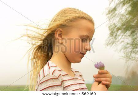 Girl Taking Spring Flower