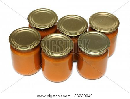 vegetable paste in glass jars on white background