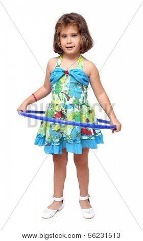 little girl doing exercises with hula hoop