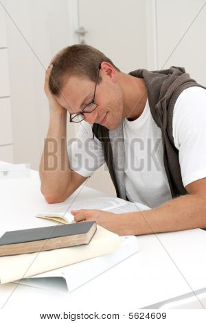 Smiling Male Student Reading