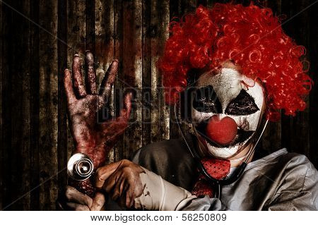 Frightening Clown Doctor Holding Amputated Hand