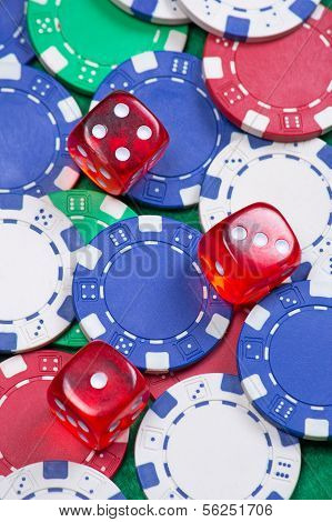 Poker Chips And Dice On The Green Table