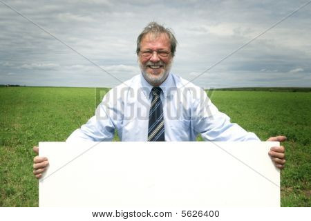 Senior man with blankboard