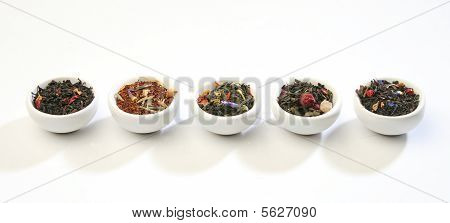 Various bowls of tea leaves