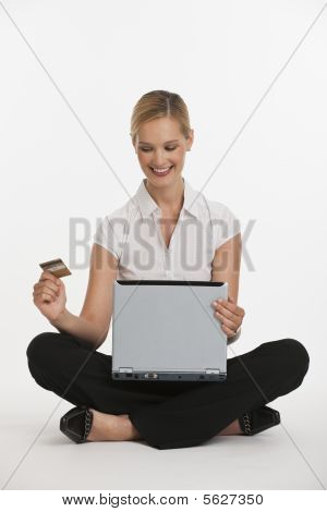 Woman With Credit Card And Computer