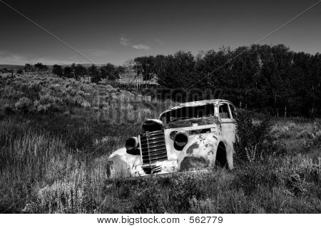 An Abandoned 1930's Car In A Field In Montana