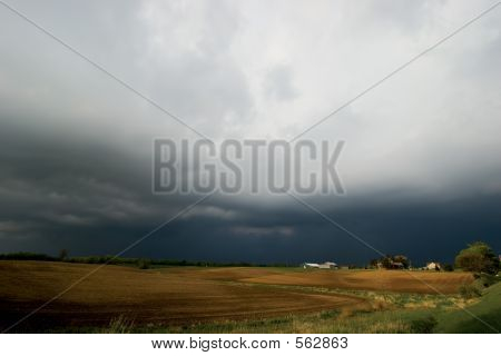 Farm Field With Background Storm