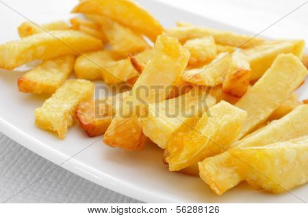 a plate with appetizing french fries on a set table
