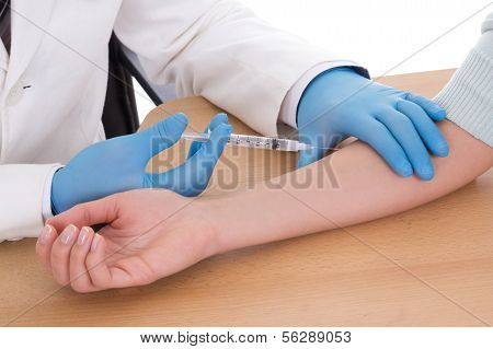 Close Up Of Doctor Giving An Injection To Woman