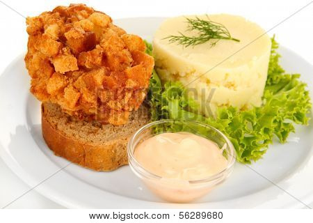 Chicken Kiev on croutons with mashed potatoes, isolated on white
