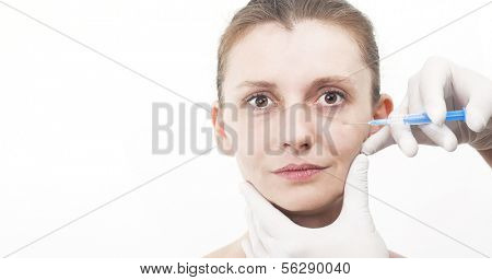 Woman getting injection to remove eye wrinkles