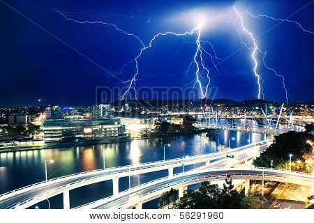 Multiple electric lightning strikes over river in Brisbane, Queensland, Australia