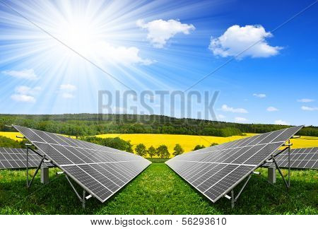 Solar energy panels against blue sky with clouds