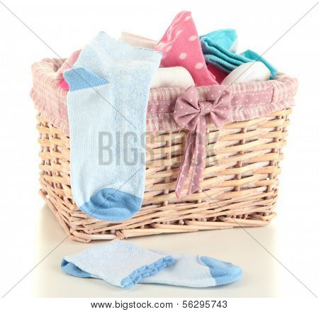 Basket with socks isolated on white