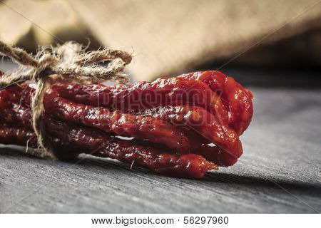 Dried Sausages On Wooden Cutting Board