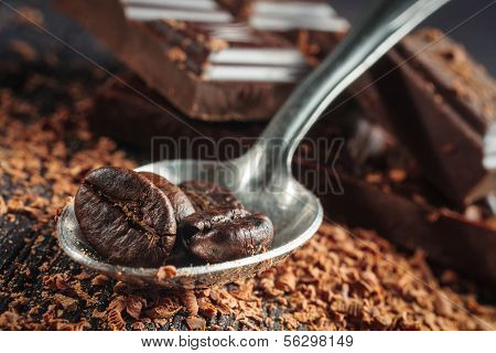 Close-up of an whole coffee beans and spoon