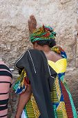 JERUSALEM, ISRAEL-MARCH 14, 2006:A woman prays at the Wailing Wall.