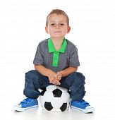 image of scandinavian descent  - Attractive young boy sitting on soccer ball - JPG