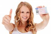 stock photo of scandinavian  - Attractive teenage girl proudly showing her drivers license - JPG