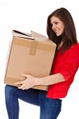 pic of scandinavian descent  - Attractive teenage girl carrying moving box - JPG