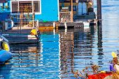 stock photo of houseboats  - Floating Home Village Blue Houseboats Reflection Inner Harbor Victoria Vancouver British Columbia Canada Pacific Northwest - JPG