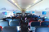 pic of boarding pass  - airplane interior  - JPG