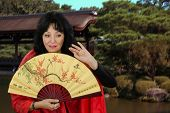 foto of geisha  - White mature actress plays the role of a Japanese geisha - JPG