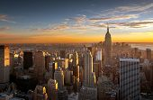 stock photo of skyscrapers  - Colorful sunset over the skyline of New York city - JPG