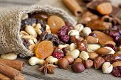 picture of ground nut  - Nuts and dried fruits on vintage wooden boards still life - JPG