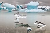 picture of arctic landscape  - Melting glacier ice Jokulsarlon lake borders National Park - JPG
