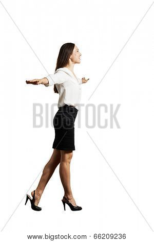 smiley businesswoman walking on invisible line. isolated on white background