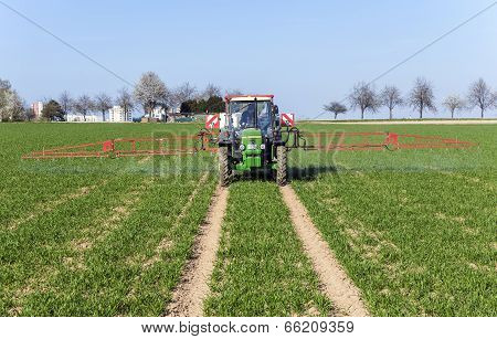 Tractor On Field Sputtering Pest Protection