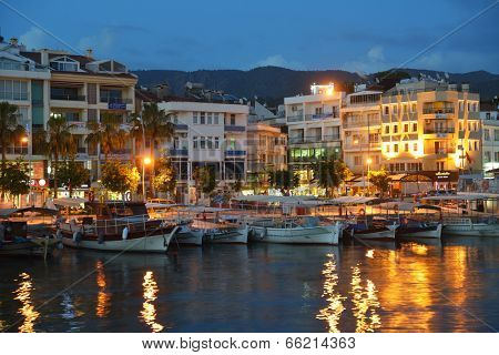 MARMARIS, TURKEY - MAY 15, 2014: Trip boats moored on the embankment in the night. Boat trips are lovely recreational activity for thousands of tourists