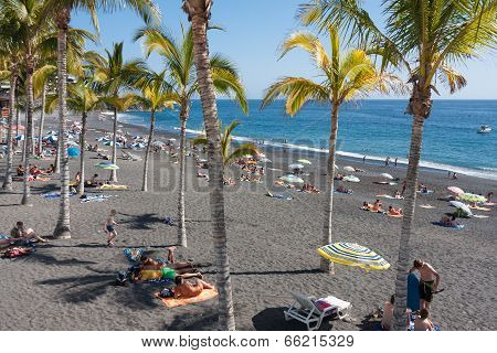Sunbathing People At Beach La Palma Island, Spain