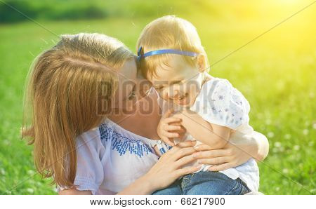 Happy Family On Nature Mother Tickle Baby Daughter And Laugh
