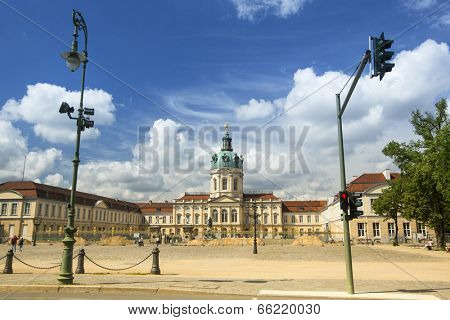 BERLIN, GERMANY - MAY 24, 2014: View of Charlottenburg Palace, is largest surviving royal palace in Berlin. The main entrance to the castle has a 48-meter dome, topped by a gilded statue of Fortune.