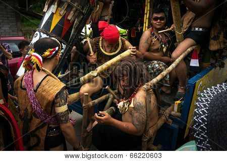 SARAWAK, MALAYSIA: JUNE 1, 2014: Musicians from the Bidayuh tribe, an indigenous native people of Borneo plays the drums in a street parade celebrating thanksgiving day, known as the Gawai festival.
