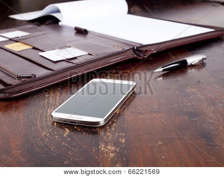 Old Fashioned Leather Folder With Blank Paper And A Modern Smartphone