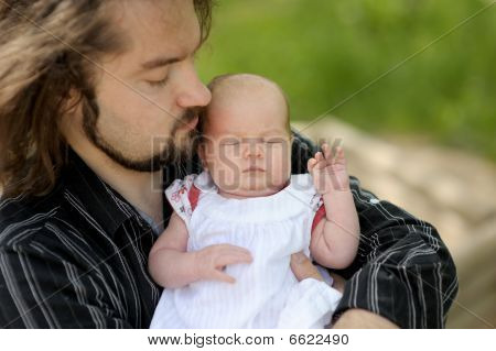 Little Newborn Baby In Father's Hands