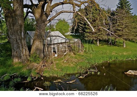 Old log cabin by the water