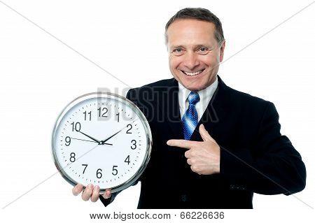 Clock Is In Business Man Hands