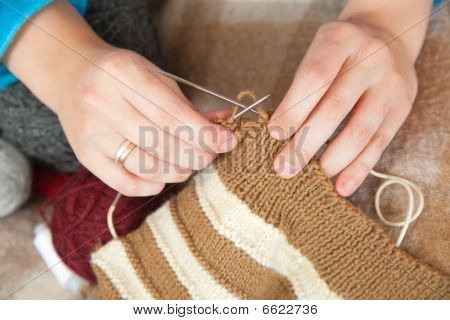 Closeup Of Knitting Woman Hands