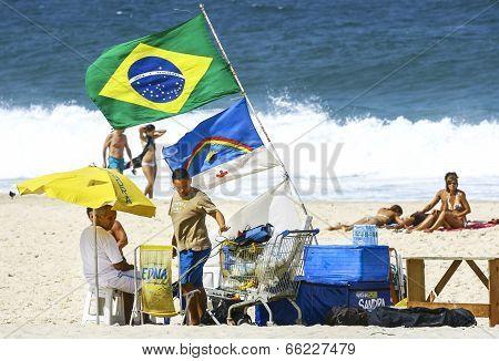 Copacabana Beach In Summer Day, Vendors And Sunbathers.